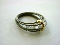 Techne SKLEP - BYCZEWSKI JACEK - RING 'Ring with moving zircons big size' [MADE TO ORDER] - gross price 1080,00 PLN/zt (Polish Zloty) ($290.47USD); Ring: stainless steel, gold (585), zircons. JB/P/R43D. biżuteria - opis szczegóółowy > (Google translation: jewelry - a szczegóółowy)