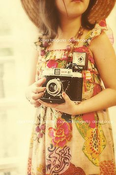 a little vintage girl with a old camera.