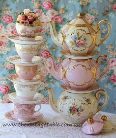 Beautiful teapots, cups, and saucers.