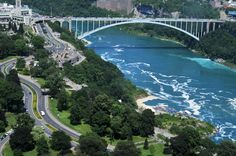 The Rainbow Bridge at Niagara Falls is an international steel arch bridge across the Niagara River gorge, and is a world-famous tourist site. It connects the cities of Niagara Falls, New York, United States (to the east), and Niagara Falls, Ontario, Canada (west).