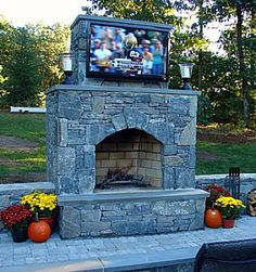 Google Image Result for http://www.backyard-design-ideas.com/images/outdoor-tv-over-fireplace.jpg