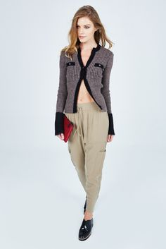 The Alter Real Cardigan by Pinko is a must have item. Pair this sweater with trousers or denim to complete the look. This cardigan can be worn alone or overtop your favorite tank.
