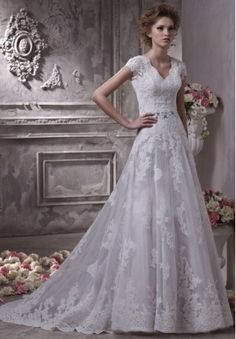 Oh my goodness. I need to stop pinning wedding dresses.  But just look at it! Amazing!