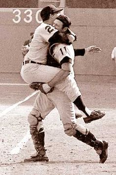 Lolich jumping into the arms of catcher Bill Freehan after Freehan caught the final out in the seventh game of the 1968 World Series.