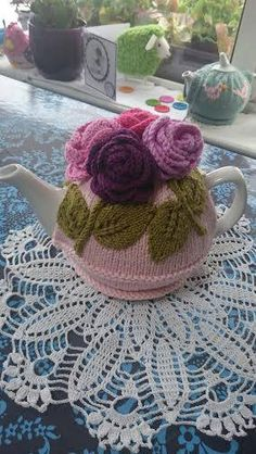 I designed this tea cosy to use at our summer tea and knitting parties. It would make a perfect gift. The one pictured in the garden was made by my friend as a wedding gift. The bride loved it Tea Cosy Knitting Pattern, Tea Cosy Pattern, Knitting Patterns, Crochet Patterns, Form Crochet, Crochet Home, Crochet Geek, Knitted Tea Cosies, Knitted Flowers