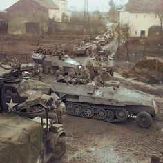 the_ww2_archives Two captured German armored half-tracks, Schützenpanzerwagen Sd.Kfz. 251 Ausf. D., join a mechanized column of armored Dodge trucks and M8 'Greyhounds' of the 3rd Battalion, 11th Infantry Regiment, 5th US Inf. Div., in Baden, Germany. 7 March 1945. 2017/01/21 12:30:08