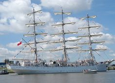"""Dar Młodzieży (""""The Gift of Youth"""") is a Polish sail training ship designed by Zygmunt Choreń. A prototype of a class of six, the following five slightly-differing units were built subsequently by the same shipyard for the merchant fleet of the former Soviet Union. Her sister ships are Mir, Druzhba, Pallada, Khersones and Nadezhda. -"""