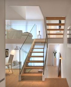 modern transparent staircase in white interior