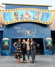 'A Wrinkle in Time' Cast Suprises Fans at Disneyland!: Photo Mindy Kaling, Oprah Winfrey, Storm Reid, and Reese Witherspoon pose for a photo in front of Sleeping Beauty's Castle at Disneyland on Thursday afternoon (February… In Time Cast, It Cast, Angela Bassett, A Wrinkle In Time, The Mindy Project, Mindy Kaling, Disneyland Resort, Reese Witherspoon, Oprah Winfrey