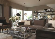 Great colors for the basement...Love the shelves in the background...awesome coffee table...Jeff Lewis - Encino