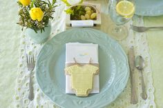 Elegant Spring Time Aqua and Yellow Outdoor Baby Shower by @Babylifestyles1. A color combination that could fit a shower theme for a boy or girl. Timeless decor and accessory items tie in with key baby shower pieces like onesie fondant cookies, baby clothes hung with clothes pins on a line and a diaper cake.