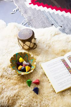 Modern child's toys with layered rugs in nursery