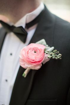 Pink Ranunculus take center stage for this boutonniere. Ranunculus are incredibly popular wedding flowers. These blooms make great additions to wedding bouquets, centerpieces, and more. Shop ranunculus in a variety of colors at GrowersBox.com!