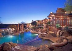 best backyard ever. Outdoor kitchen, fire pit, 60 ft swimming pool w/ underwater stereo, spa, sunken tennis court, guest house, pool house, and a baseball field. I want to be this guys wife...