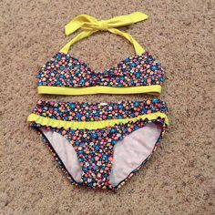NWOT vibrant floral patterned bikini New without tags neon floral patterned Justice bikini. Justice girls size 12. In AMAZING condition! Never been worn before. Has removable padding. Justice Swim