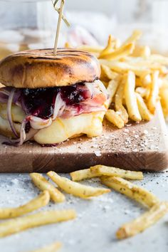 A juicy Monte Cristo Burger topped with smoked ham, blueberry jam and melted Arla Muenster Cheese.: