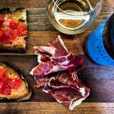 Eating jamon  in the office by @ skinnermatt: