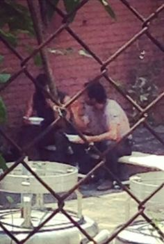 Andy and Norman on a lunch break. It's funny cause it's behind the gate. Someone was probably stalking them. Lol