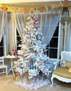 My pastel Christmas tree decorated with houses and churches!