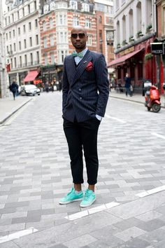 London Collections Men Street Style - David Nyanzi, photographer - Wearing: vintage glasses, jacket and waistcoat, H bowtie and trousers, Hugo Boss shirt and Adidas shoes.