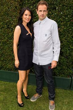 Lucy Liu & Johnny Lee Miller    Elementary stars Luci Liu (clad in a low-cut Marios Schwab dress) and Johnny Lee Miller will make a fine Dr. Watson and Sherlock Holmes indeed.