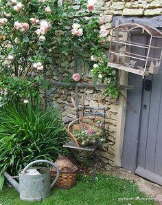 Love the bird cage over the old grey door