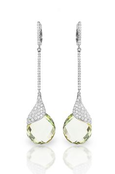 """Be a vision in Haute Vault's dramatic,18K white gold, green amethyst and diamond drenched earrings. Our long drop earrings feature a striking shade of green adorned with sparkling white diamonds, sure to set off your chic cocktail or black tie look. Leave an unforgettable impression by pairing with one of our white diamond cocktail bands and diamond tennis bracelets.  Measures 2 1/4"""" long; Available for rental at www.hautevault.com"""