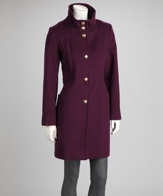 A chilly forecast is the perfect excuse to cover up, and this trendy coat is just the thing to keep shivers at bay. The plum hue and high-standing collar update the classic silhouette, while a warm wool blend provides a toasty feel.Measurements (size 4): 35'' long from high point of shoulder to hem80% wool / 20% nylonDry cleanImported