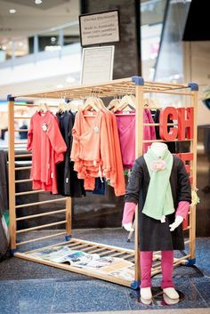 Old playpen used as market clothes rack...neat idea !