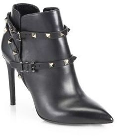 "Studded wrap-around ankle straps add signature appeal to these point-toe booties in supple Italian leather. Self-covered heel, 4"" (100mm)Leather upperSide ventsAdjustable double ankle strapLeather lining and solePadded insoleMade in Italy"