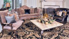 Transitional style living room ensemble featuring leathers, woods & damask fabric prints with oriental rug & accessories