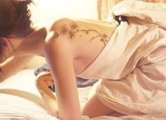 love elegant back tattoos with trees/vines/flowers