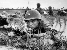 The Associated Press photographer Huynh Thanh My covers a Vietnamese battalion pinned down in a Mekong Delta rice paddy about a month before he was killed in combat on Oct. 10, 1965. (AP PHOTO)
