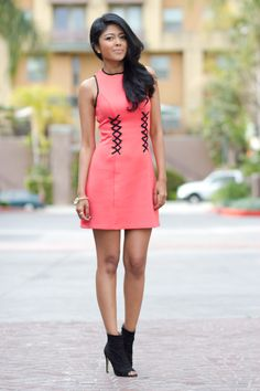 Dark hair girl is wearing a coral dress with lace up details at the waist. An accent like this (especially in contrasting color) will create an illusion of a thin waist and feminine hourglass figure. Only Fashion, Fashion News, Fashion Outfits, Women's Fashion, Coral Dress, Lace Dress, Prom Dress, Wedding Dress, Everything Pink