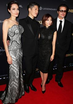 Now that's the look of love! Angelina Jolie and Brad Pitt made their first official appearance as a married couple on Monday evening in Australia, hitting the red carpet for the world premiere of Unbroken at the State Theatre in Sydney. Mrs. Pitt was radiant in a strapless black lace Gucci gown with a white underlay for…