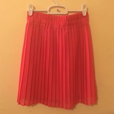 Necessary Objects Skirt NWOT coral colored chiffon skirt from Urban. Looks best at the natural waist and can be easily dressed up or down Urban Outfitters Skirts Mini