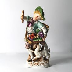 Vintage Porcelain Figurine of a Boy and his Dog