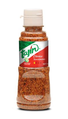 Tajin Fruit and Snack Seasoning Clasico 5.3 oz --- Tajin seasoning is a powdered concoction made of ground chili peppers, salt, and dehydrated lime juice. I discovered this Mexican staple during a recent farmer's market trip where it was sprinkled on fresh sliced heirloom tomatoes...like salt-sprinkled tomatoes bumped up a notch with a bit of lemon and peppery kick! We like to sprinkle this zesty seasoning on top of popcorn, cucumber stalks, tomato slices, watermelon, and so much more. Yum!