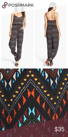 Geometric Print Jumpsuit! Super cute tribal jumpsuit! Worn a twice in great condition. Has a scrunch waist as well as scrunch ankles. Has adjustable straps and a tie waist Originally bought from Nordstrom. 0 Other