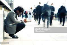 Affluent city works hurry past a motionless homeless character.... #humble: Affluent city works hurry past a motionless homeless… #humble