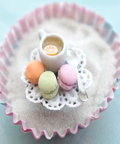 This ring features handmade french macarons along with a miniature cup of lemon tea and spoon. The minis sit on a dainty white doily that is attached to an adjustable filigree ring. if you have specia