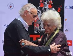 Marvel comic book writer Stan Lee and actress Nichelle Nichols participate in a hand and footprint ceremony immortalizing Lee in the…