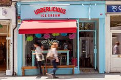 If you have a sweet tooth then follow us now to a magical boutique ice creamery, in the heart of Islington and the aptly named Udderlicious! Since they opened their doors in late 2013, owners, partners and ice cream fanatics Raj and Raj Kotecha, have been delighting Londoners with their gourmet ice creams and sumptuous sorbets. Everyone remembers the first time they discovered the magic of ice cream and at Udderlicious you can relive that joy all over again. From the beautiful 'how-to' mural... Gourmet Ice Cream, Ice Creamery, Great Names, Ice Cream Parlor, Parlour, Store Fronts, Set Design, Sweet Tooth, Cow