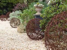 Rusty barbwire balls - look cool, but probably not too safe to have in the garden