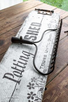Rustic potting shed sign with an old rake to hold garden tools, made with Funky Junk's Old Sign Stencils & Fusion paint / funkyjunkinteriors.net