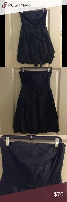 Romeo and Juliet Couture strapless dress This is a black strapless dress with an empire waist. There is boning in the bust area for coverage and support. The bottom half of the dress is a pleated pattern. Romeo & Juliet Couture Dresses Mini
