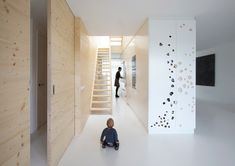 A floor to ceiling sliding door becomes part of the wall.