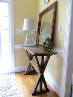 This table is built out of only 2x4's - that's 5 boards for about $15! It was pretty easy and took half a day. If the fancy angles are too hard to cut safely I recommend doing 45-degree angles! I'm happy to have a nice entryway - first time my whole life! :)