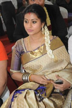 Sneha in Cream Kanjiveram Saree with Gold Border and Shimmering Blouse with Pearl Work