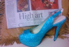 Turquoise crystals encrust a suede leather shoe with a platform front. sizes available: euro 34-42